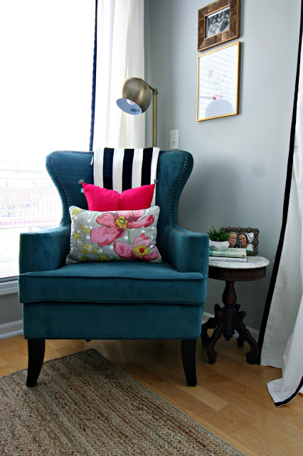 living room corner with olie pillow ikea throw and world market chair